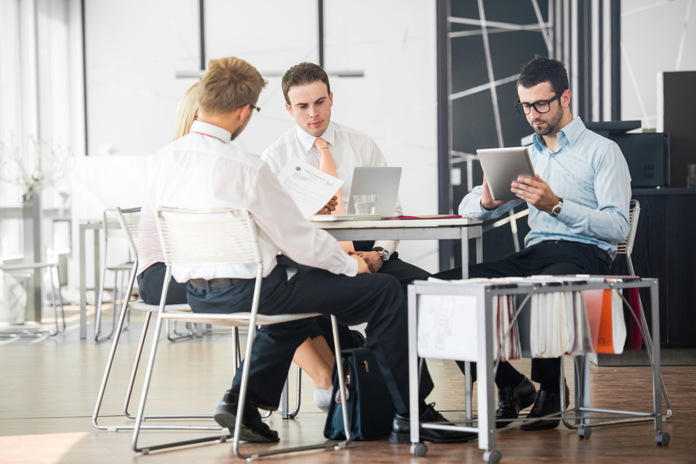 Corporate team working on a meeting in office